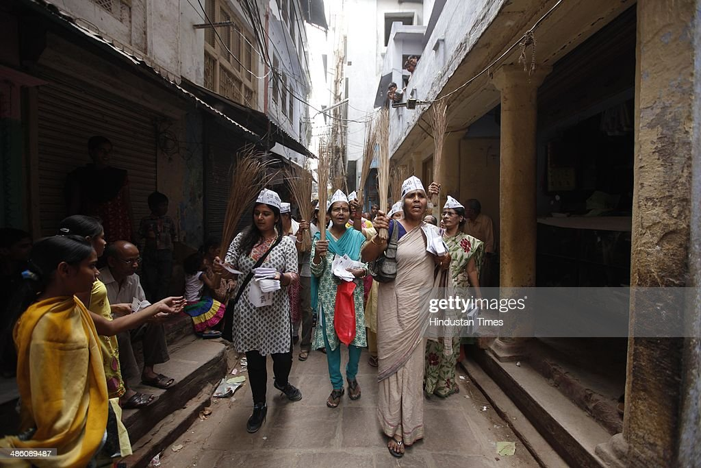 AAP volunteers distributing pamphlets during an election campaign on April 22, 2014 in Varanasi, India. Narendra Modi will file his nomination from Varanasi on April 24. His rival contestants are Aam Aadmi Party leader Arvind Kejriwal, Ajay Rai of the Congress and Kailash Chaurasia of the Samajwadi Party