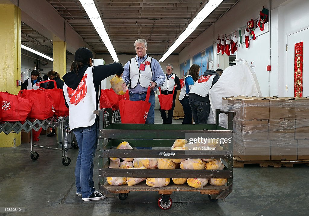 Volunteers fill bags with food to be given away during the Salvation Army's Toy & Joy Shop Distribution on December 20, 2012 in San Francisco, California. With less than one week before Christmas, the Salvation Army's Golden State division held a Toy & Joy Shop Distribution event that allows families in need to shop for free toys and receive a bag with ingredients to make a holiday meal. Nearly 1,500 families will attend the two day event.