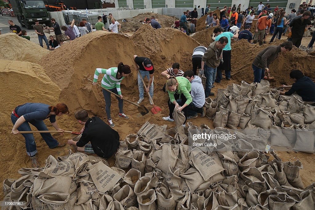 Volunteers fill sandbags to protect the city from rising floodwaters of the swollen Elbe river on June 6, 2013 in Dresden, Germany. Eastern and southern Germany are suffering under floods that in some cases are the worst in 400 years. At least four people are dead and tens of thousands have evacuated their homes.