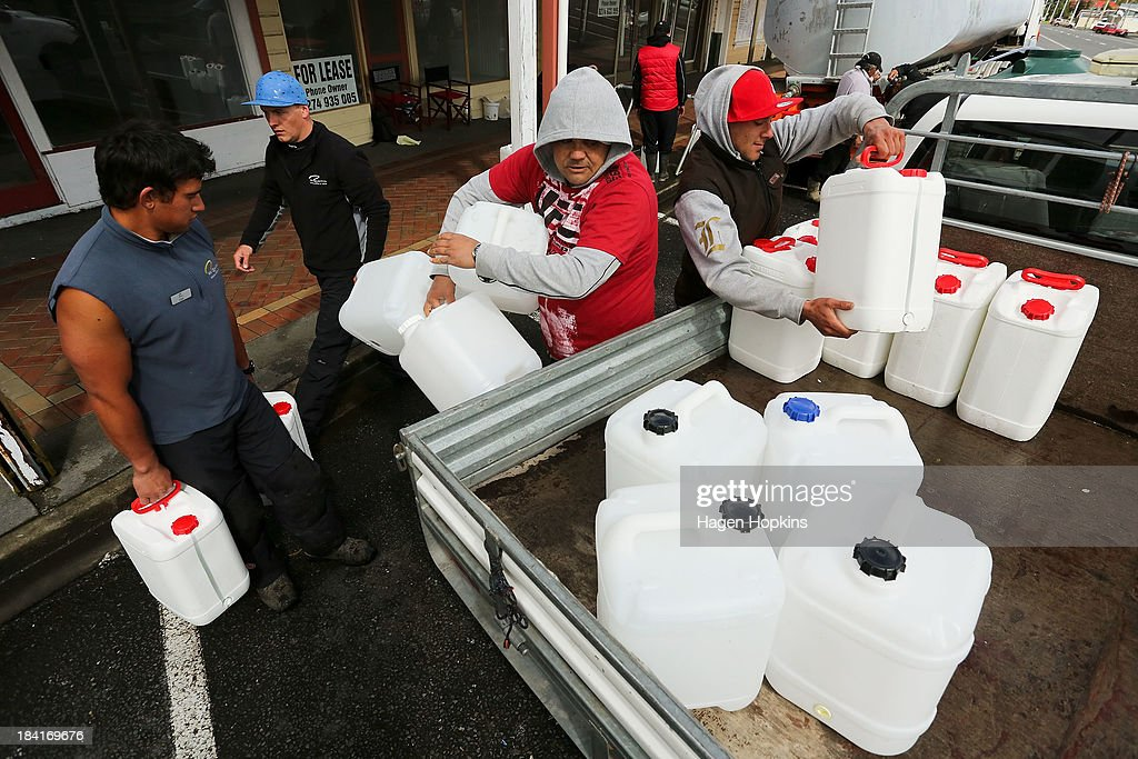 Volunteers fill water containers for delivery to local houses on October 12, 2013 in Raetihi, New Zealand. Work has begun to flush a stream contaminated by a large diesel spill at Tongariro National Park. A tank from the Turoa Ski Field has leaked 15,000 litres of diesel into the Makotuku stream.