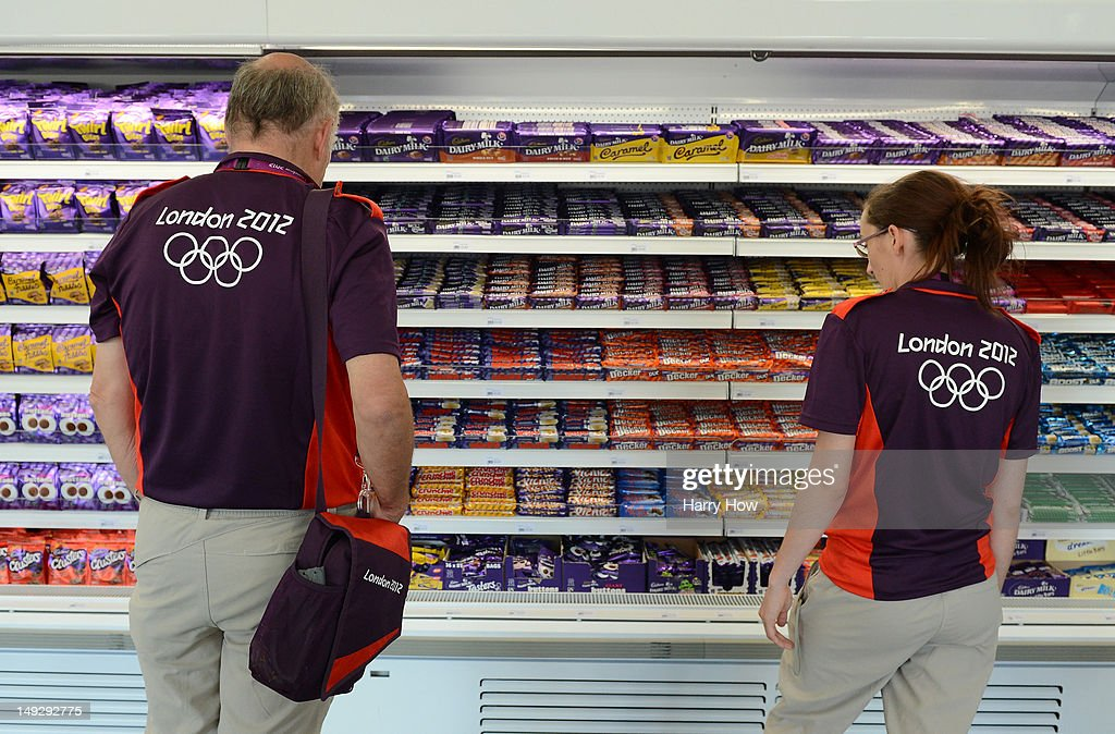 Volunteers for London 2012 decide on a chocolate in the general store at the Olympic Village on July 26 2012 in London England