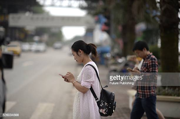 Volunteers from a college participate in a campaign against phubbing in a tourist zone on April 29 2016 in Fuling China Smartphone addicts are...
