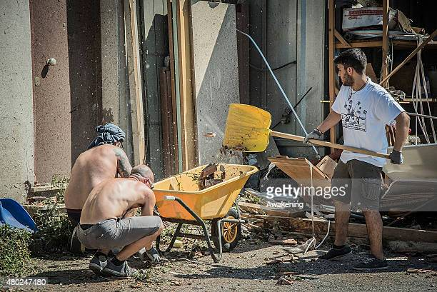 Volunteers from 'Centri Sociali Nord Est' help in clearing the damage caused by the tornado on July 10 2015 in Venice Italy One person died 87...