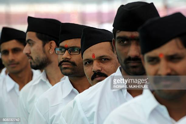 Volunteers from Indian right wing organisation Rashtriya Swayamsevak Sangh queue as they arrive for a rally in Pune some 135 kms southeast of Mumbai...