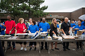 Volunteers from St Paul Public Schools serve food to guests outside JJ Hill Montessori School on July 14 2016 in St Paul Minnesota The meal was...