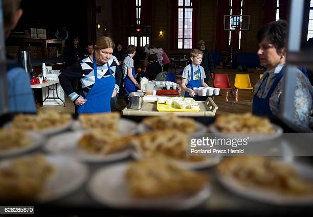 Volunteers from the Portland Rotary Club serve Thanksgiving dinner at the St Vincent DePaul soup kitchen The Portland Rotary Club has been putting on...
