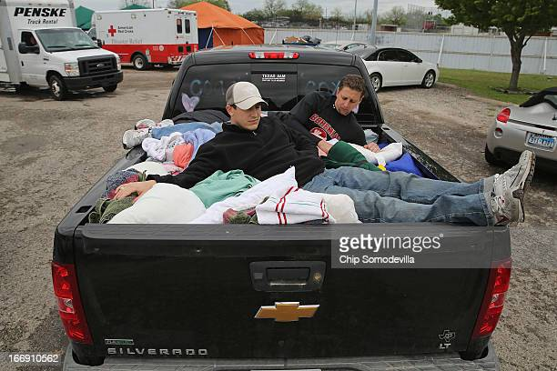 Volunteers gather and transport donated bedding outside the West Community Center the day after the West Fertilizer Company explosion April 18 2013...