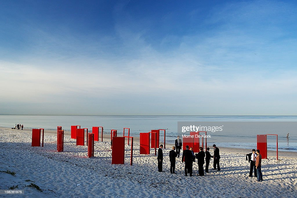 Volunteers gather to pose as they take part in an installation by surrealist artist, Andrew Baines at Henley Beach on December 13, 2012 in Adelaide, Australia. The installation was called 'Doorways To Potential'.
