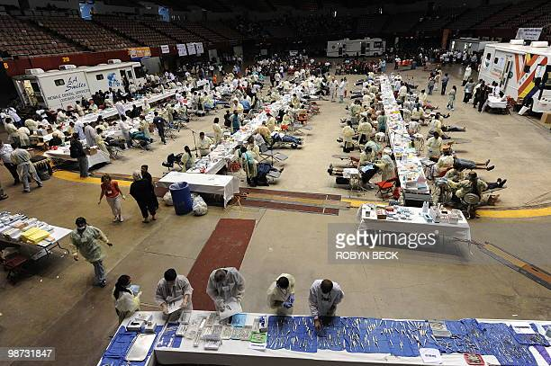 Volunteers gets dental tools for dentists giving free dental care at a clinic at the Los Angeles Sports Arena sponsored by Remote Area Medical a...