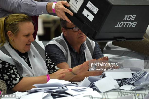 Volunteers go through ballots cast for a byelection in Stoke on Trent United Kingdom on February 23 2016 The populist right wing UKIP party were...