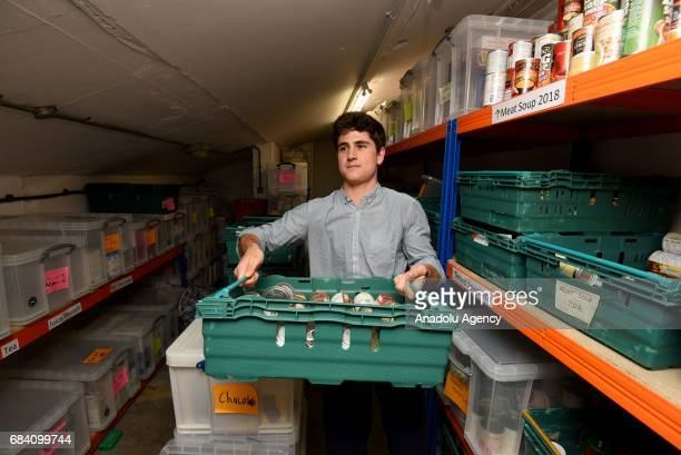 Volunteers Guilhem Chevallereau sorts through food donations from the public at Oasis Foodbank Waterloo in London United Kingdom on May 16 2017...