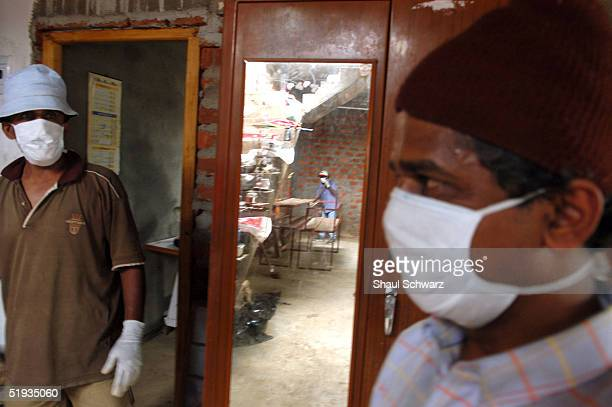 Volunteers help clean a house that has been damaged but still stands January 9 2005 in Matara Sri Lanka Hundreds of locals living inland have come...