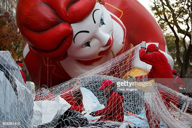 Volunteers help prepare the Thomas the Tank Engine balloon prior to Thursday's Macy's Thanksgiving Day Parade November 23 2016 in New York City This...