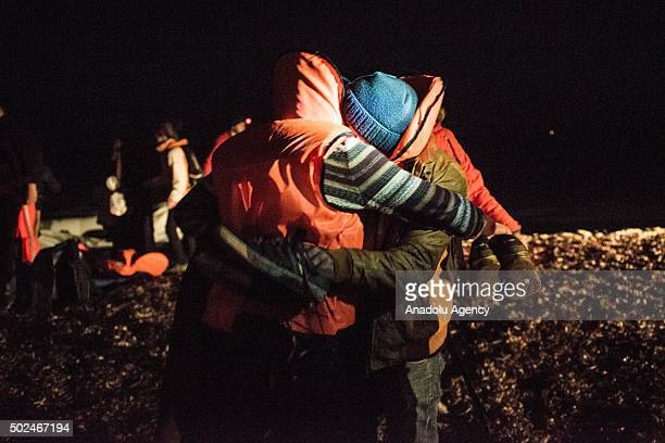Volunteers help refugees upon their arrival on Mytilene of Lesbos Island Greece after crossing the Aegean sea from Turkey on December 25 2015