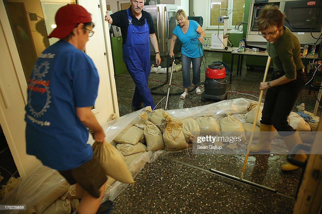 Volunteers help to clear rising ground water from the basement of a technical training center near the swollen Elbe river on June 9, 2013 in Magdeburg, Germany. Magdeburg is enduring its highest floodwaters in its 1,200 year history and several city districts are underwater. Catastrophic flooding has hit portions of southern and eastern Germany that has left at least seven people dead and forced tens of thousands to flee their homes. Towns in northern Germany downstream from the Elbe are also bracing for floods in coming days.