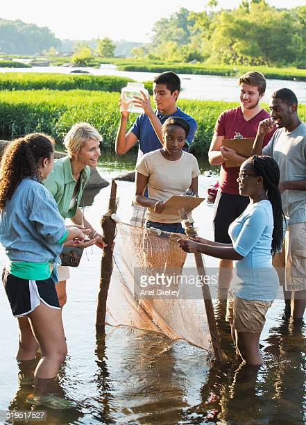 Volunteers holding net in river
