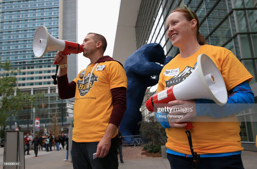 Volunteers Jeff Stover and Erica Gutting welcome festival goers to the 32nd annual Great American Beer Festival at the Colorado Convention Center on October 10, 2013 in Denver, Colorado. The GABF runs October 10-12 and 49,000 attendees will be offered 3100 beers from 624 breweries.