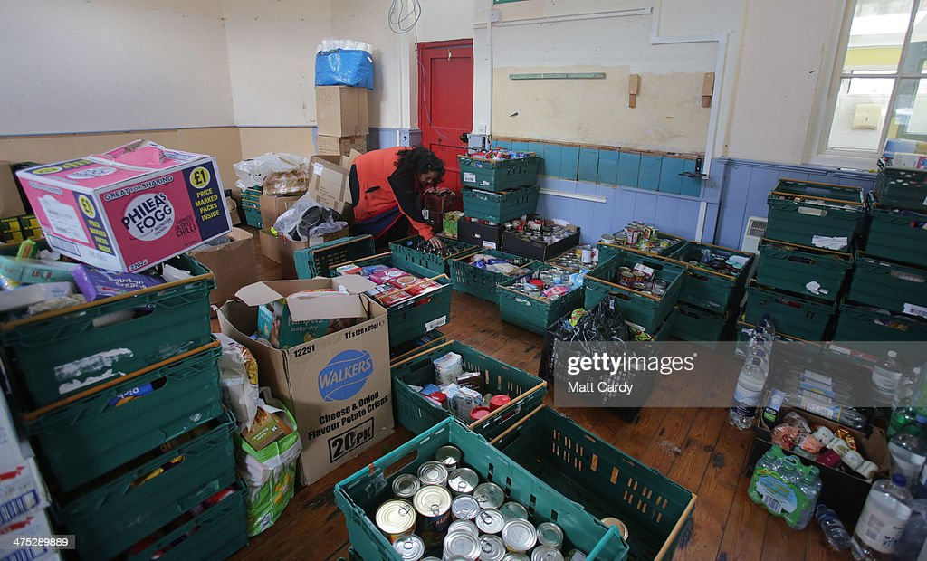 A volunteers looks at supplies that have been donated to flood victims at Burrowbridge on the Somerset Levels on February 27, 2014 in Somerset, England. According to the Met Office, England and Wales have experienced their wettest winter since records began in 1766, with parts of flood-hit southern England having experienced 83% more rain than average.