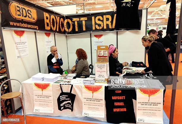 Volunteers man a proPalestinian stand advocating the boycott of Israel in the commercial space of the 31st annual meeting of the Muslims of France...