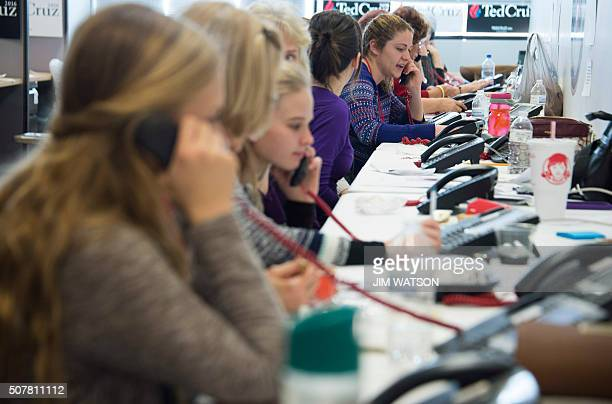 Volunteers man the phone banks at Republican presidential candidate Ted Cruz's headquarters in West Des Moines Iowa January 31 ahead of the Iowa...