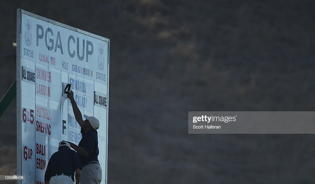 Volunteers mark a score on a leaderboard during the Afternoon Foursomes Matches at the 25th PGA Cup at the CordeValle Golf Club on September 16, 2011 in San Martin, California.