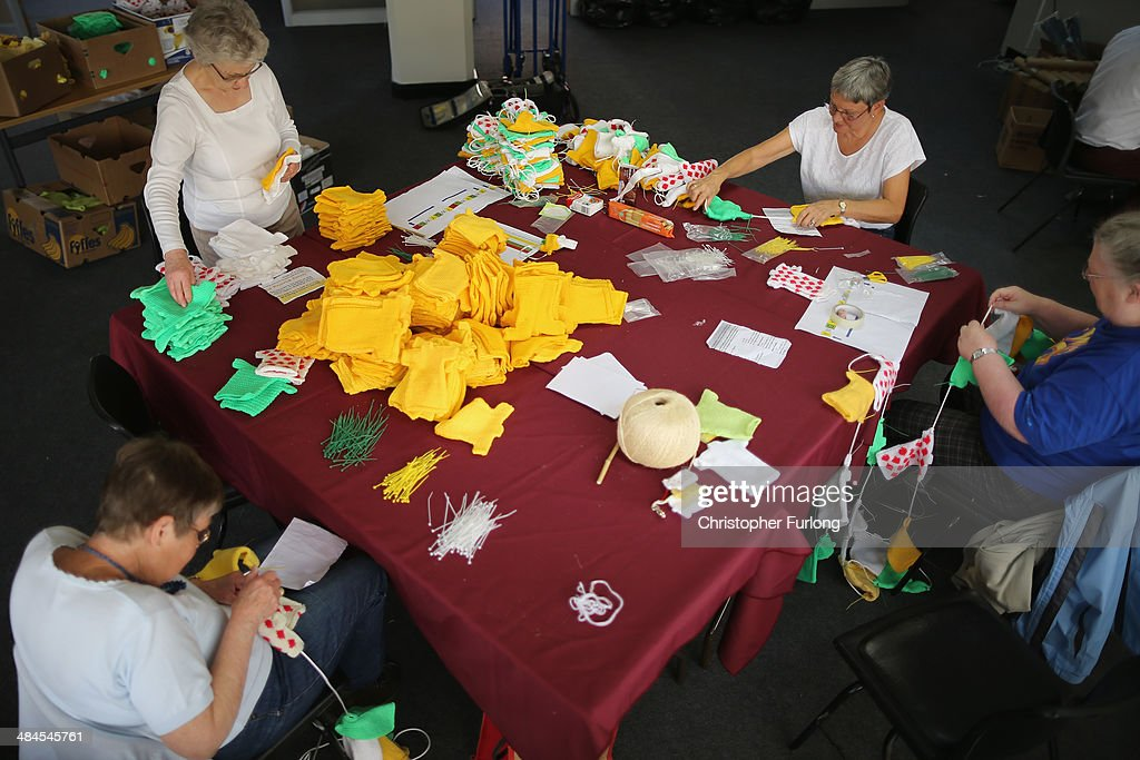 Volunteers, (L-R) Mary Russell, Sheila Franks, Ann Powell and Vicky Bee string together some of the thousands of hand knitted miniature jerseys that will be used as bunting to decorate the streets and lanes of Harrogate when the Tour de France makes its way through Yorkshire, on April 11, 2014 in Harrogate, England. Over 23000 hand knitted woollen jerseys have been made by volunteers to decorate the route of the Yorkshire Grand Depart of the Tour de France 2014 .