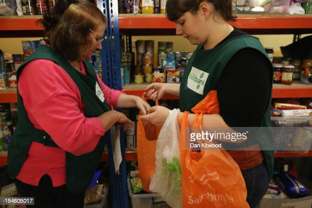 Volunteers Maureen Wiltshire and Lydia Higham put a selection of tinned food together for a client at a Food Bank depot at St Paul's Church in...
