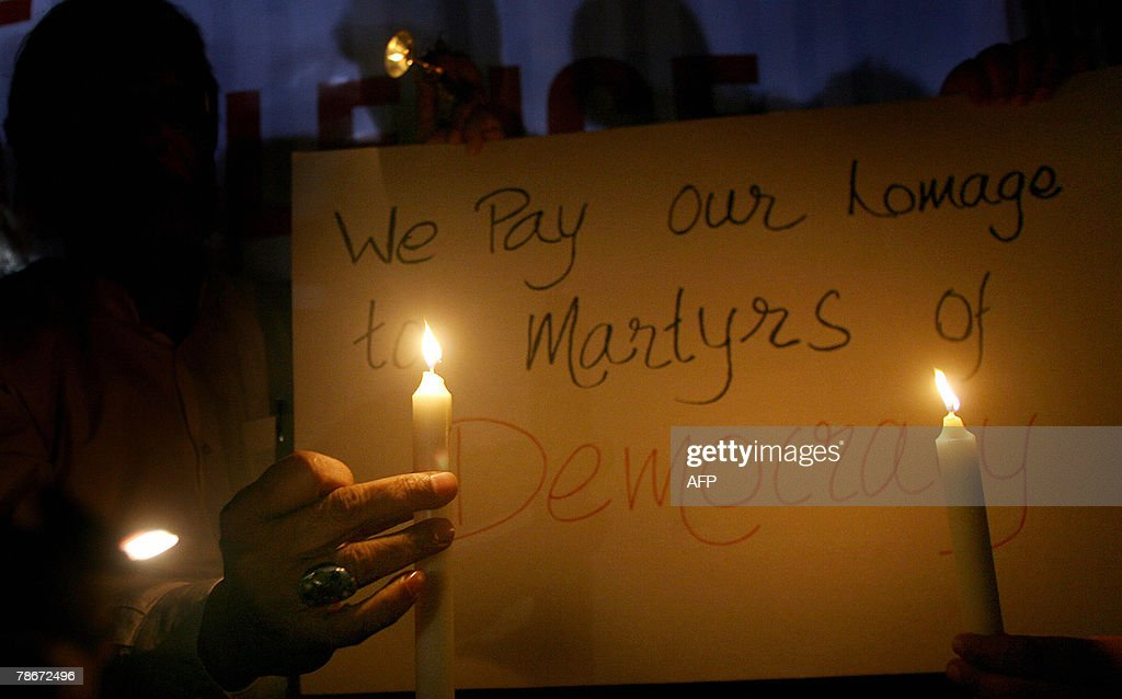 Volunteers of an Indian peace forum hold candles during a vigil in memory of slain former Pakistani Prime Minister Benazir Bhutto, in Mumbai, 29 December 2007. Bhutto was assassinated by a suicide bomber, plunging the nation into one of the worst crises in its history and raising alarm around the world. Violence erupted in cities across Pakistan,Pakistani paramilitary forces in the southern city have been ordered to shoot rioters on sight to prevent unrest after the assassination of former Prime Minister Benazir Bhutto, a paramilitary officer said.AFP PHOTO/Pal PILLAI