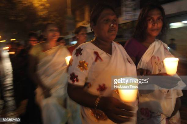 Volunteers of Darpan Foundation of Kamathipura held Candle light March in awareness of 1st December World Aids Day in Mumbai on Sunday