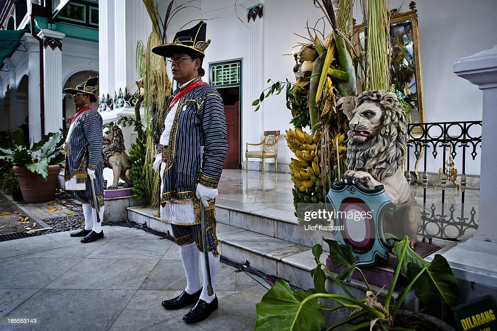 Volunteers of Kraton Palace, known as 'Abdi Dalem', stand guard at Kraton Palace during the Royal Wedding Held For Sultan Hamengkubuwono X's Daughter Gusti Ratu Kanjeng Hayu And KPH Notonegoro on October 22, 2013 in Yogyakarta, Indonesia. Wedding celebrations will take place October 21-23 October. The wedding parade will include 12 royal horse drawn carriages and will be streamed live on the internet so that it can be watched by people all over the world.