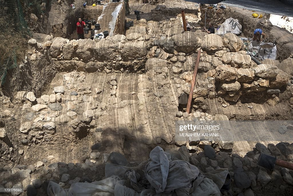 Volunteers of the Hebrew University work during an excavation in the Northern Israeli archeological site of the ancient Tel Hazor, where they found the remains of a Sphinx with a hieroglyphic inscription between its paws dating circa 3rd century BCE, on July 9 2013. The Sphinx was sculpted for Egyptian King Mycerinus, one of the builders of the Giza pyramids, and this is the first time ever a statue dedicated to Mycerinus has been uncovered, and the first time such a finding has been unearthed in the Levant.