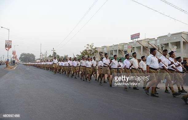 Volunteers of the Hindu nationalist organisation the Rashtriya Swayamsevak Sangh participate in a Parade on the second day of their conference on the...