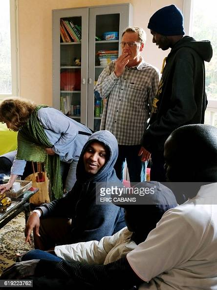 Volunteers of the village welcome Sudanese refugees in the 'Centre dAccueil et dOrientation pour migrants' in Bruniquel near Montauban southern...