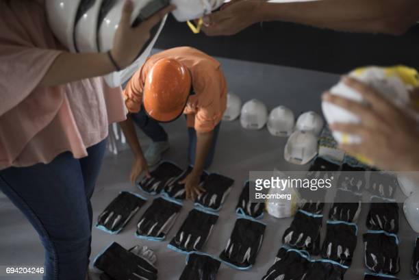 Volunteers organize protective gear to distribute to protesters before a demonstration in Caracas Venezuela on Wednesday May 31 2017 Theneardaily...