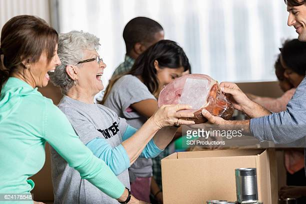 Volunteers pack up food packages at food bank