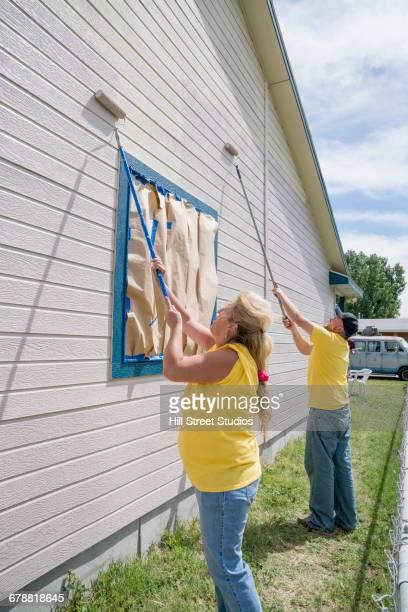 Volunteers painting house