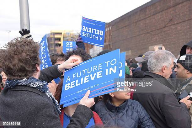Volunteers pass out signs to supporters Senator Bernie Sanders addressed a rally in Greenpoint Brooklyn's WNYC Transmitter Park attended by some one...