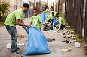 Volunteers picking up litter in alley