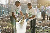 Volunteers picking up litter in urban lot