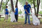 Volunteers picking up trash in park