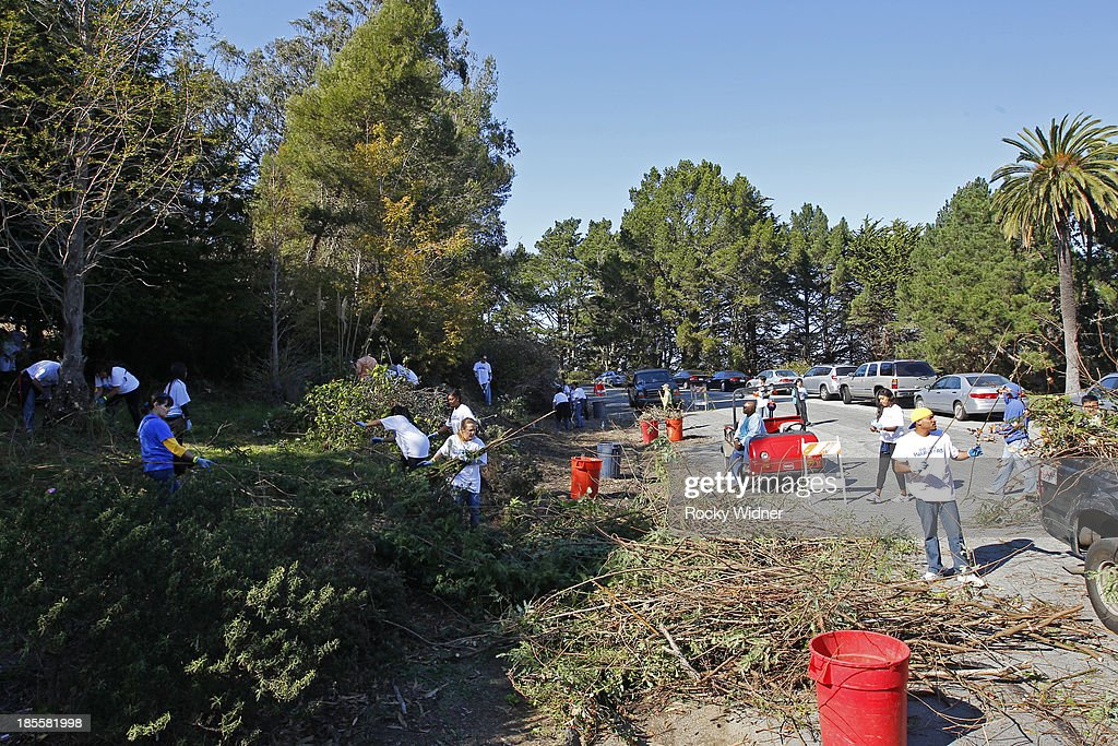 Volunteers pitch in to clean up McLaren park during Warriors Day Of Service as part of NBA Cares Week Of Service on October 21, 2013 in San Francisco, California.