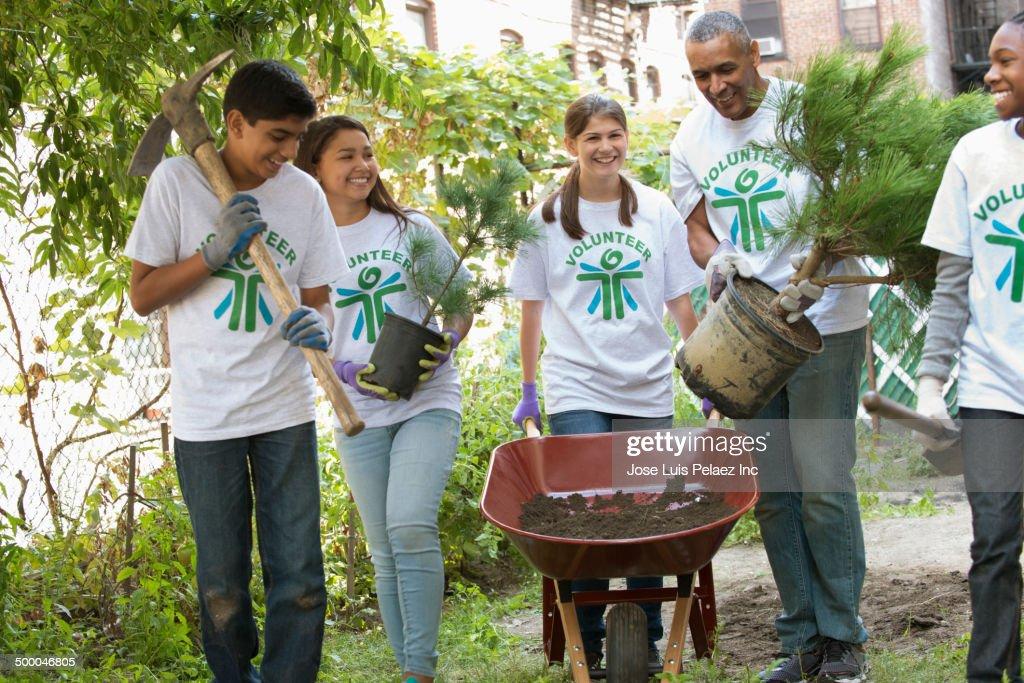 Volunteers planting trees in urban park