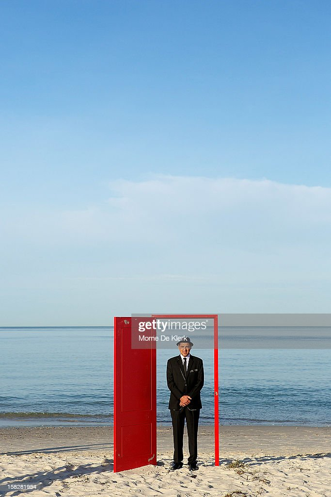 Volunteers pose as they take part in an installation by surrealist artist, Andrew Baines at Henley Beach on December 13, 2012 in Adelaide, Australia. The installation was called 'Doorways To Potential'.