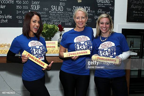Volunteers pose with Toblerone chocolate bars at Girl And The Bull A Dinner hosted by Stephanie Izard and Ken Oringer as a part of the Bank of...