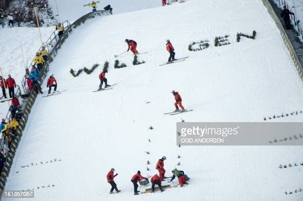 Volunteers prepare a show jump after the cancellation of the FIS Ski Jumping World Cup individual large hill competition on the Muehlenkopfschanze...
