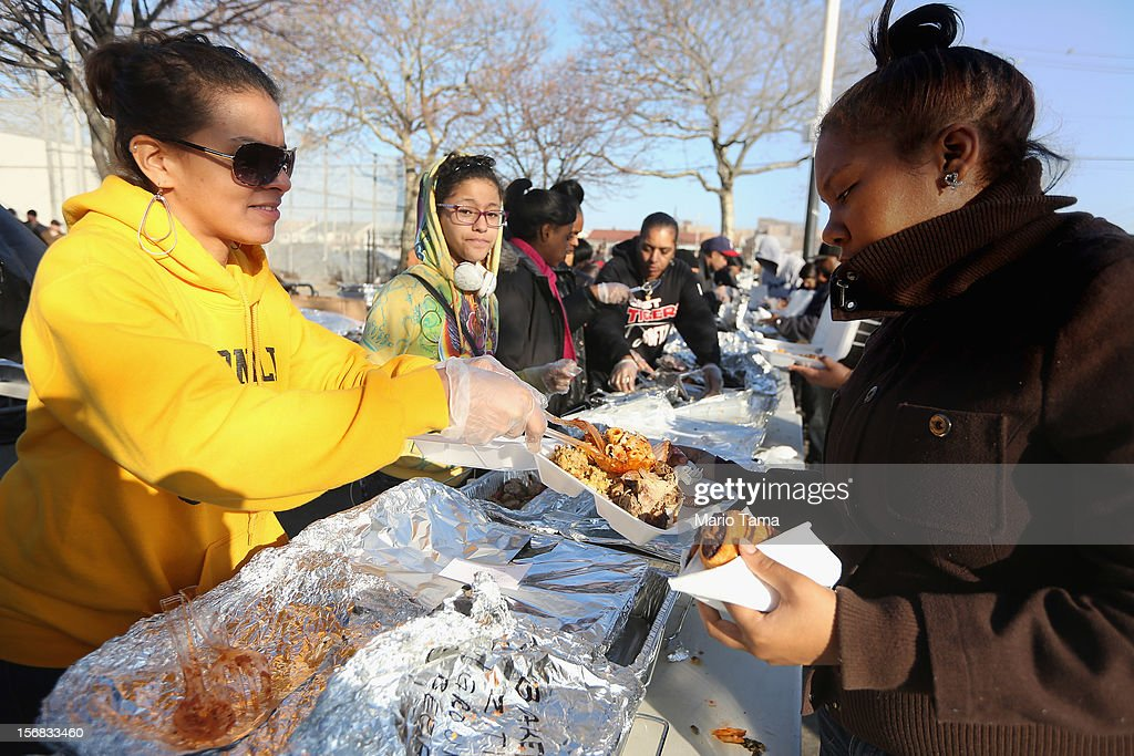 Volunteers prepare donated Thanksgiving dinners to residents in the Rockaway neighborhood on November 22, 2012 in the Queens borough of New York City. A number of organizations are providing free Thanksgiving meals for residents of the Rockaways which was hard hit by Superstorm Sandy.