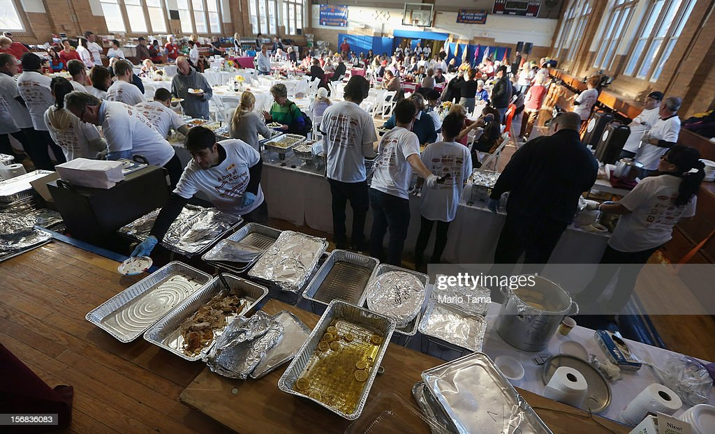 Volunteers prepare free Thanksgiving dinners at St. Francis de Sales Parish in the Rockaway neighborhood on November 22, 2012 in the Queens borough of New York City. A number of organizations are providing free Thanksgiving meals for residents of the Rockaways which was hard hit by Superstorm Sandy.