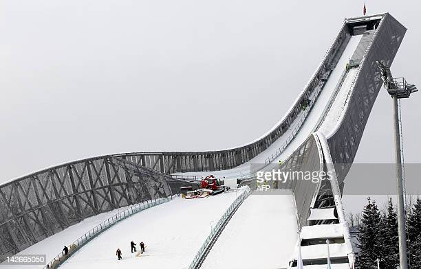 Volunteers prepare the jumping hill in Holmenkollen the day before the start of the Nordic Skiing World Championships in Oslo on February 23 2011 AFP...