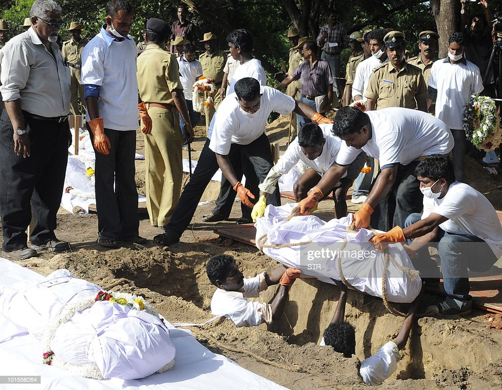 Volunteers prepare to bury one of 12 unidentified bodies who perished May 22 in the Air India Express flight 812 crash, in Mangalore on June 2, 2010. The Air India Express Boeing 737-800, carrying 160 passengers and six crew on a flight from Dubai, careered off the 'table-top' runway at Bajpe airport May 22 and ploughed into a forested gorge, bursting into flames.