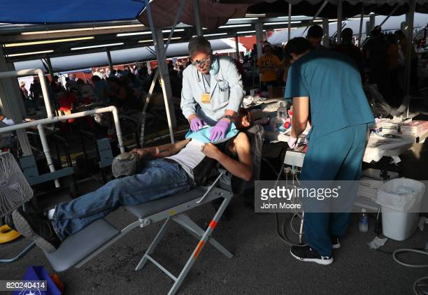 Volunteers provide free dental services to patients at the Remote Area Medical mobile clinic on July 21 2017 in Wise Virginia RAM holds the threeday...